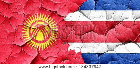 Kyrgyzstan flag with Costa Rica flag on a grunge cracked wall