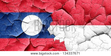 Laos flag with Indonesia flag on a grunge cracked wall