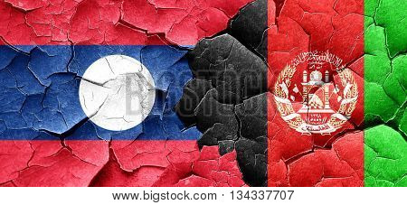 Laos flag with afghanistan flag on a grunge cracked wall