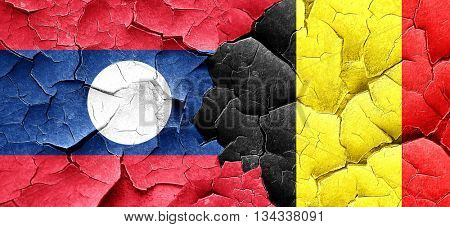 Laos flag with Belgium flag on a grunge cracked wall