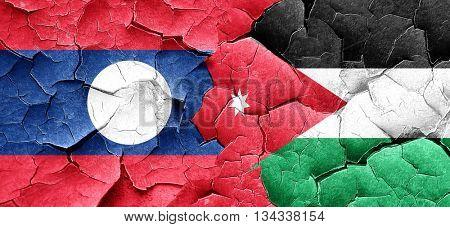 Laos flag with Jordan flag on a grunge cracked wall