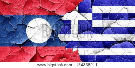 Laos flag with Greece flag on a grunge cracked wall