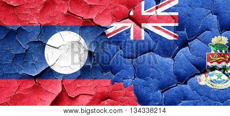 Laos flag with Cayman islands flag on a grunge cracked wall