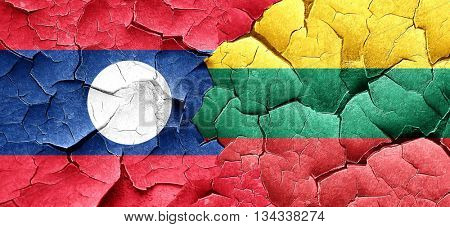 Laos flag with Lithuania flag on a grunge cracked wall