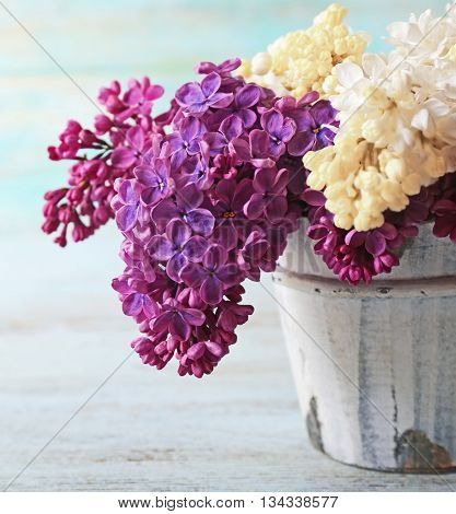 Fresh lilac on wooden background