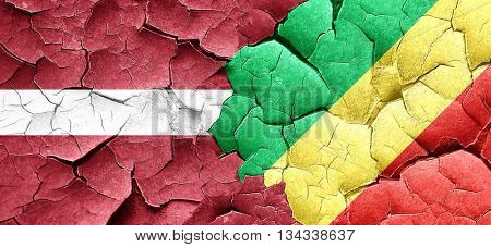 Latvia flag with congo flag on a grunge cracked wall