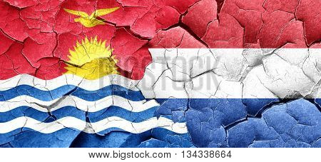 Kiribati flag with Netherlands flag on a grunge cracked wall