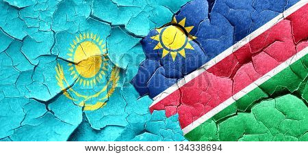 Kazakhstan flag with Namibia flag on a grunge cracked wall