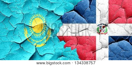 Kazakhstan flag with Dominican Republic flag on a grunge cracked