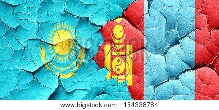 Kazakhstan flag with Mongolia flag on a grunge cracked wall