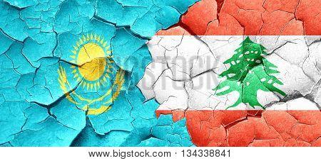 Kazakhstan flag with Lebanon flag on a grunge cracked wall