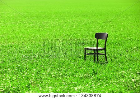 Black wooden chair on the wheat field