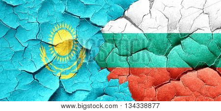 Kazakhstan flag with Bulgaria flag on a grunge cracked wall