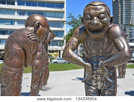VANCOUVER BC CANADA JUNE 15 2015: A-maze-ing Laughter is a 2009 bronze sculpture by Yue Minjun, located in Morton Park in Vancouver, British Columbia, Canada