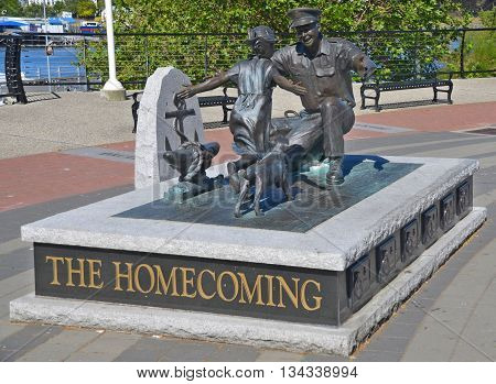 VICTORIA BC CANADA JUNE 24 2015: 'The Homecoming' by Nathan Scott, which is a bronze figure sculpture commemorating the 100th Anniversary for the Canadian Navy and displayed downtown Victoria BC