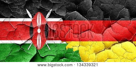 Kenya flag with Germany flag on a grunge cracked wall