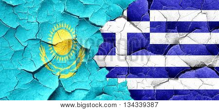 Kazakhstan flag with Greece flag on a grunge cracked wall