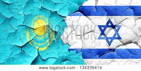 Kazakhstan flag with Israel flag on a grunge cracked wall