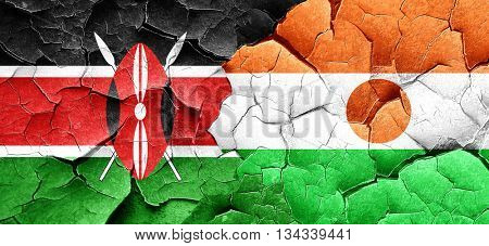 Kenya flag with Niger flag on a grunge cracked wall