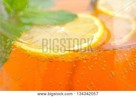 Homemade lemonade in the glass macro