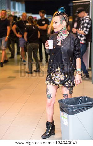 KRAKOW, POLAND - JUNE 12, 2016: Unidentified festival participant during the 11-th International Tattoo Convention in the Congress-EXPO Center of Krakow.