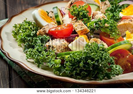 Fresh Salad With Chicken, Tomatoes, Eggs And Lettuce On Plate
