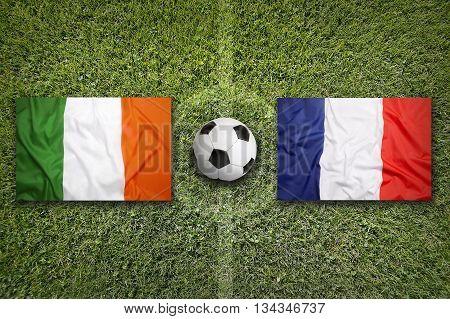Ireland Vs. France Flags On Soccer Field