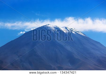 dormant volcano on the background of the sky