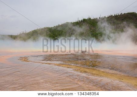 Beautiful cinematic view of nature landscape in the American West under the blue cloudy sky. Geyser.