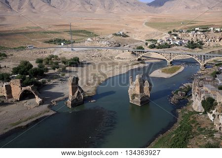 Hasankeyf village (Southeastern Anatolia). Aerial view from the Fortress on the Tigris River with remains of the Old Bridge in Turkey.
