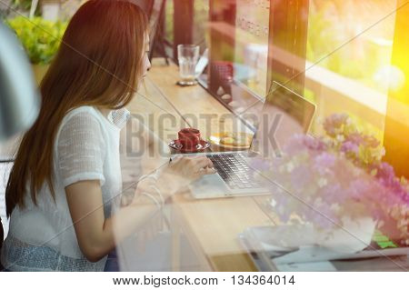 Asia Woman Using Laptop In Coffee Shop