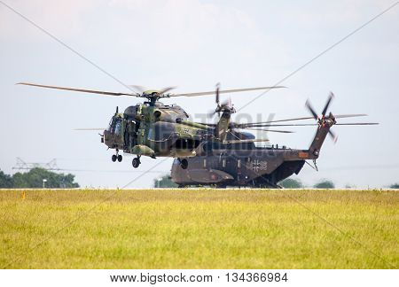 BERLIN / GERMANY - JUNE 3 2016: german military transport helicopters nh 90 and ch 53 lands on airfield in berlin germany at june 3 2016.