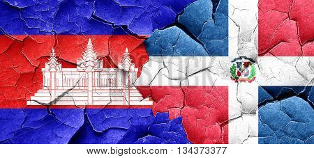 Cambodia flag with Dominican Republic flag on a grunge cracked w