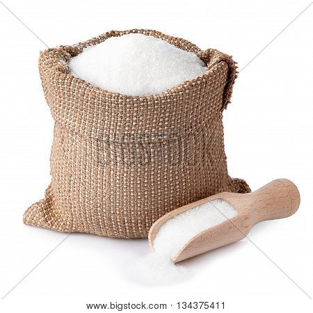 sugar in burlap sack with wooden scoop isolated on white background. Full bag of sugar crystals closeup. Sugar