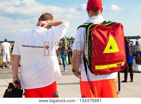 BERLIN / GERMANY - JUNE 3 2016: german paramedics from deutsches rotes kreuz stands on airport berlin germany at june 3 2016.