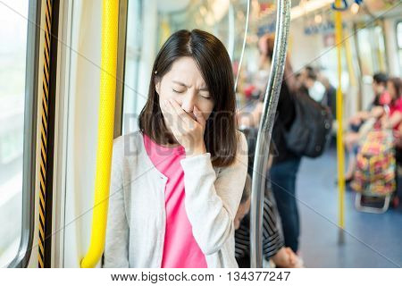 Woman getting sick in train compartment