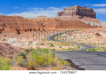 Colorful Road In Desert Painted With Different Color Sediments And Rocks Near Goblin Valley State Pa