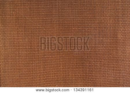 A woven brown canvas material textured background.