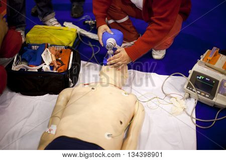 Artificial respiration. First aid training. Paramedic demonstrate Cardiopulmonary resuscitation (CPR) on dummy.