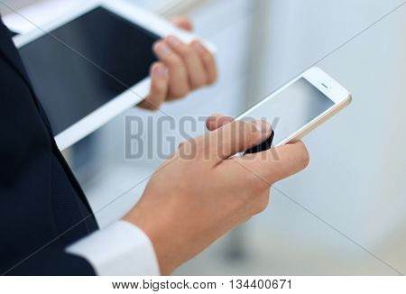 businessman working with modern devices digital tablet computer and mobile phone