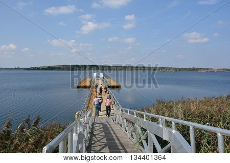 Floating jetty on the new lake. The lake is created from a former opencast mine.