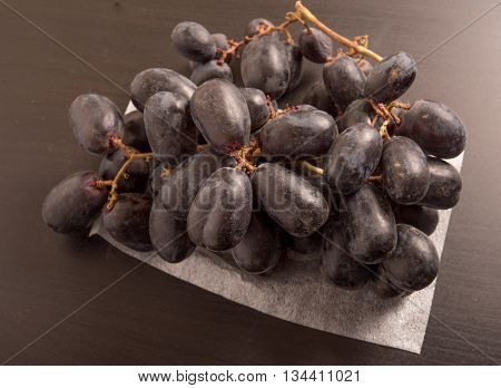 Bunch of Delicious and fresh black seedless grape