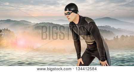 Swimmer in wetsuit and swimming goggles against beautiful day in the water