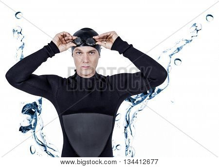 Swimmer in wetsuit wearing swimming goggles against water bubbling on white surface