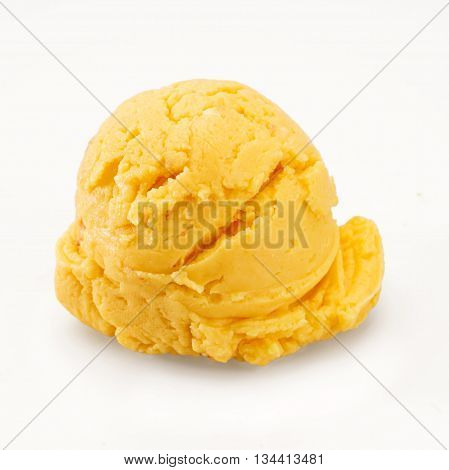 Scoop of orange, yellow ice cream isolated on white