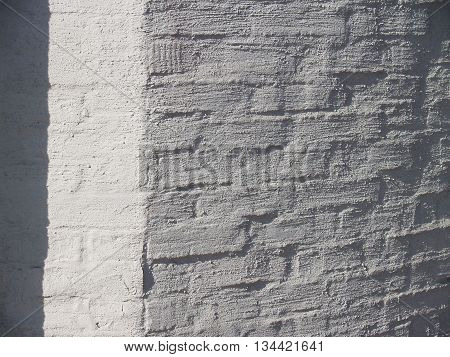 Beautiful textured white plastered surface of a brick facade closeup