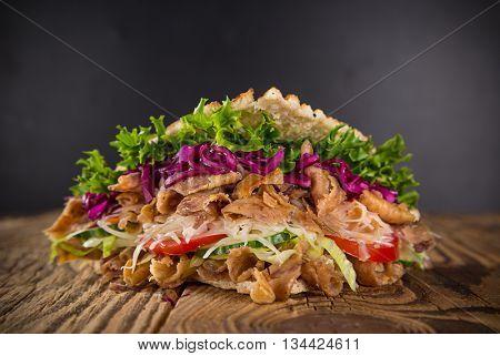 Kebab sandwich on wooden background
