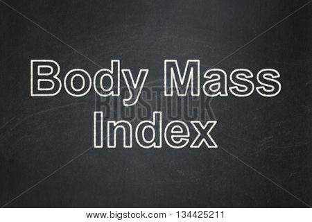 Healthcare concept: text Body Mass Index on Black chalkboard background