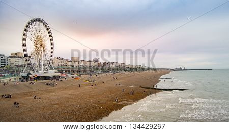 Brighton United Kingdom - July 18 2015 - Seaside view of Brighton at sunset. Brighton is a popular seaside town in south England.