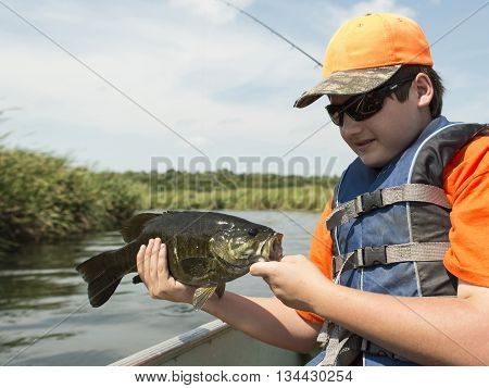 Bass Fisherman with a Small Mouth bass